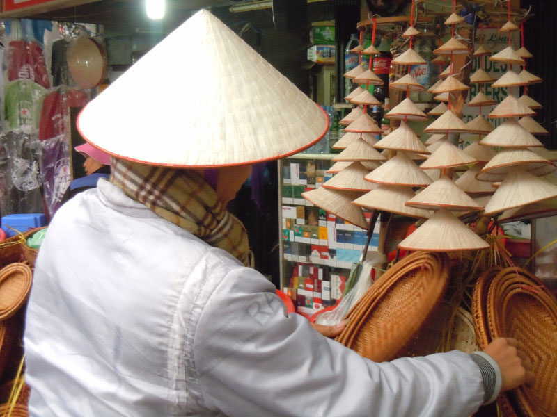 Seller of coolie hats, Hanoi, Vietnam